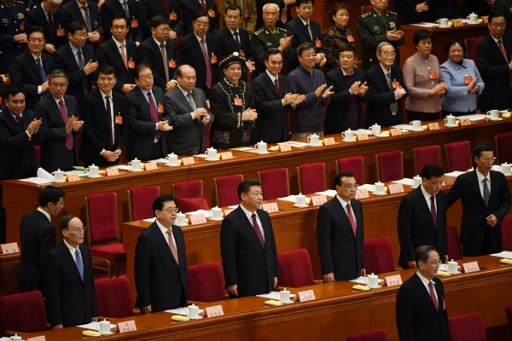 China's Politburo Standing Committee at the opening session of the Chinese People's Political Consultative Conference. Photo: AFP, Greg Baker