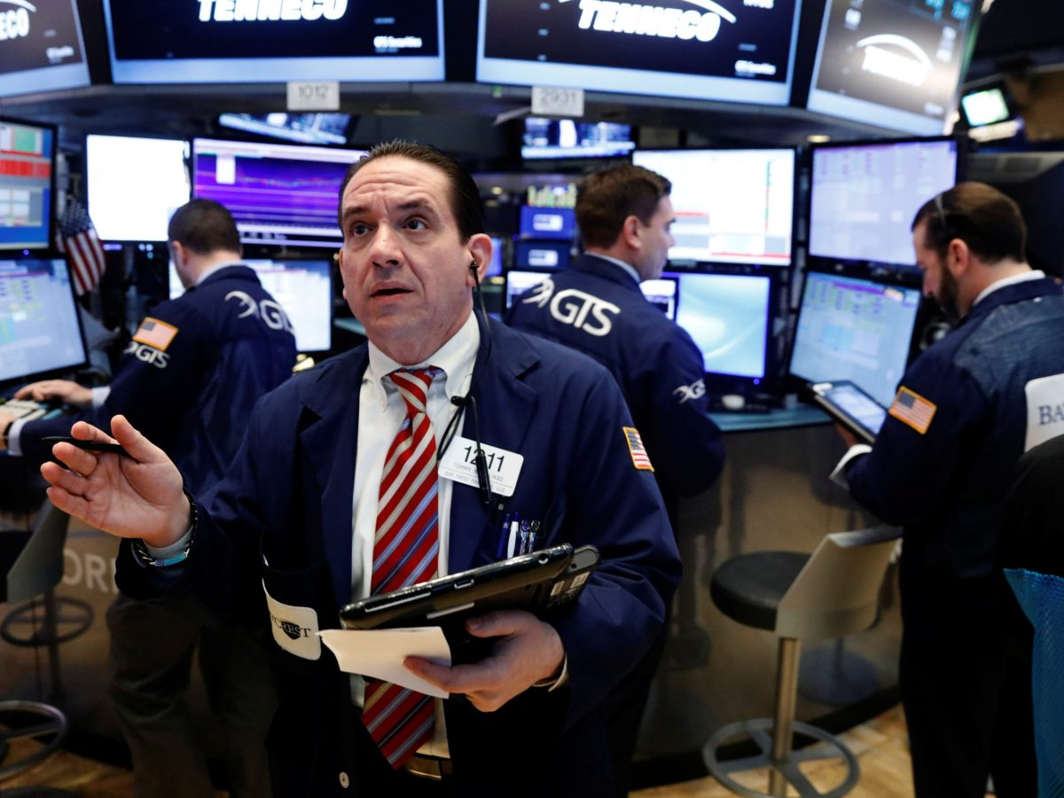 Traders work on the floor of the New York Stock Exchange. Photo: Reuters/Lucas Jackson