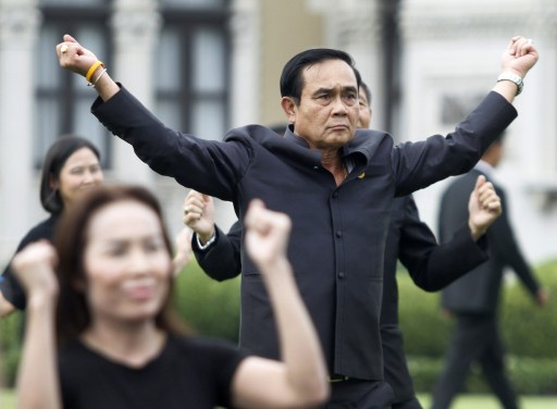 Prime Minister Prayut Chan-o-cha leads cabinet ministers and officials in an exercise session at Government House. Photo: Bangkok Post, Thanarak Khunton