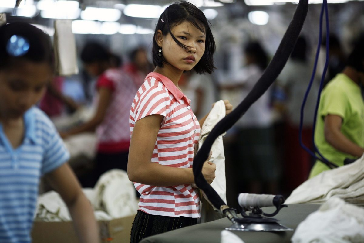 A worker looks on at a garment factory at Hlaing Tar Yar industry zone in Yangon. Photo: Reuters / Soe Zeya Tun