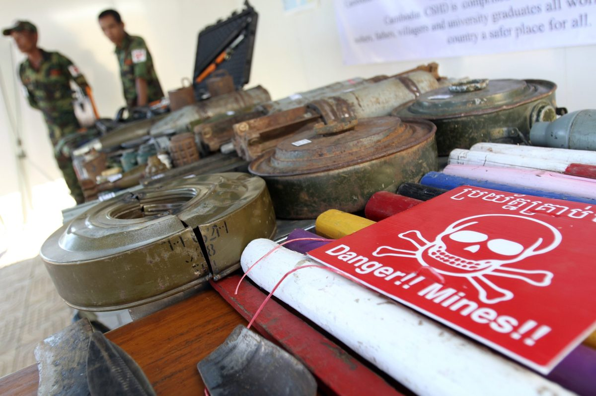 Cambodian soldiers stand near unexploded ordnance during a media and international delegation visit at the Demining Center in Kampong Speu province. The US dropped tons of ordnance on Cambodia during its wider Vietnam War campaign that is still littered across the Cambodian countryside. Photo: Reuters / Samrang Pring