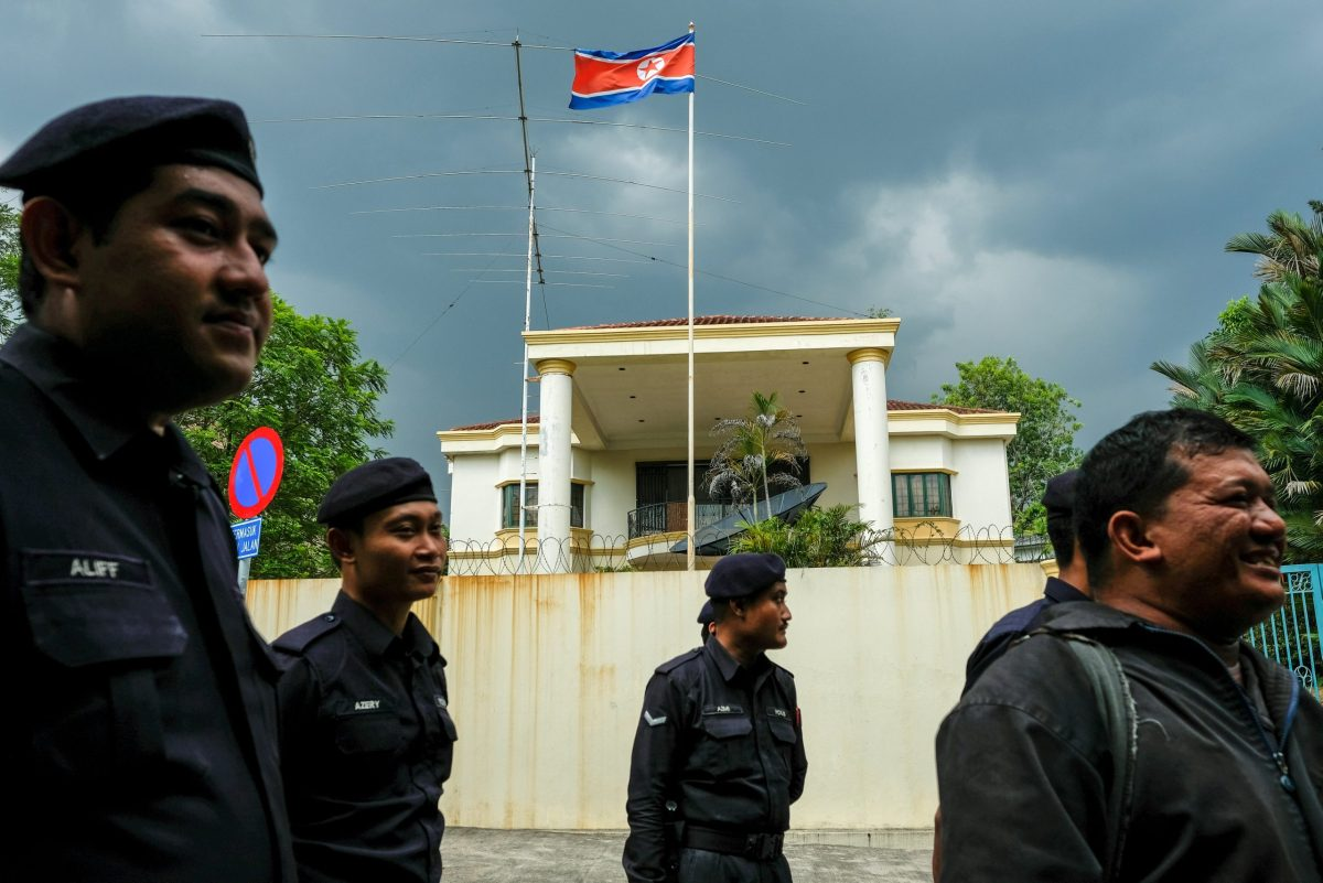 Malaysian police officers gather before a protest organized by the youth wing of the National Front, Malaysia's ruling coalition, in front of the North Korea embassy, following the murder of Kim Jong-nam in Kuala Lumpur. Photo: Reuters/Athit Perawongmetha