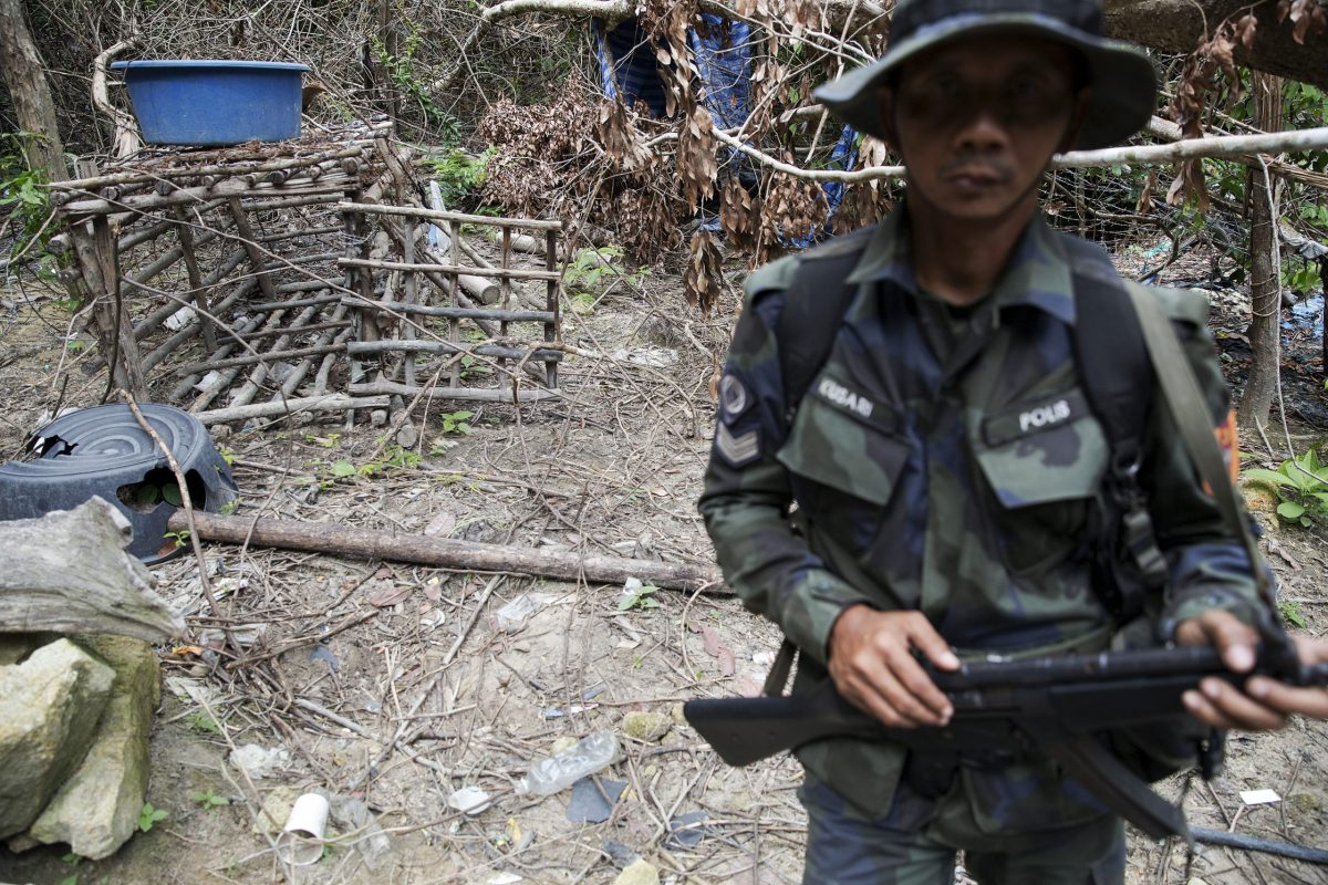 A cage made of barbed wire and bamboo sticks that Malaysian police said was used to hold migrants is seen at an abandoned human trafficking camp in the jungle close to the Thai border. This shot was taken on May 26, 2015, as Malaysian forensic police began the grim task of exhuming bodies of dozens of suspected victims of traffickers found buried around these camps.  Photo: Reuters/Damir Sagolj.