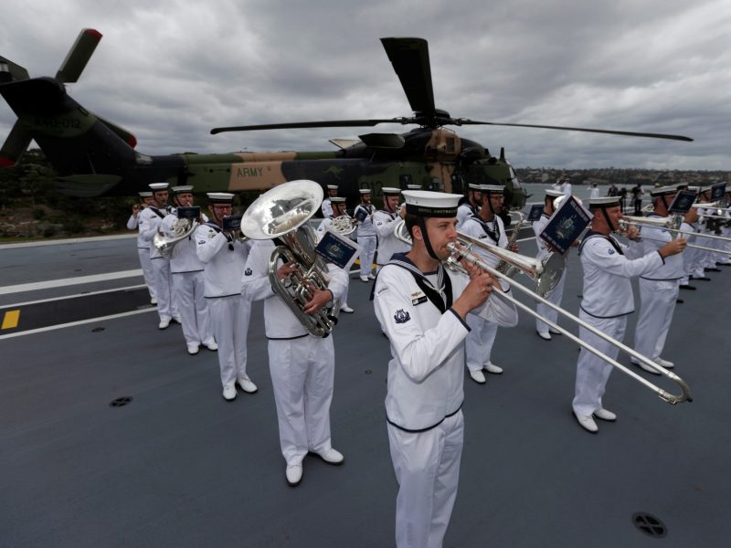 An Australian Navy band plays national anthems on the Australian Navy ship HMAS Adelaide in Sydney, December 19, 2016.   Photo: Reuters / Jason Reed