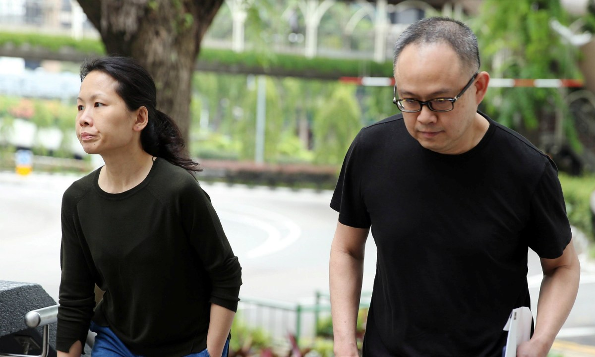 Chong Sui Foon and Lim Choon Hong, who were charged for starving their Filipino domestic helper, arrive at the State Courts for a hearing in Singapore Monday. Photo: The Straits Times/Wong Kwai Chow via REUTERS
