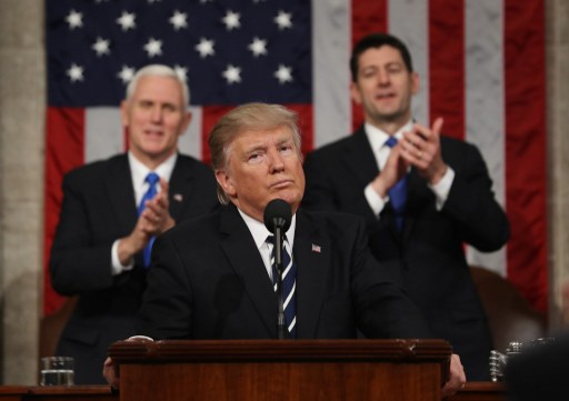 US President Donald J. Trump reacts after delivering his first address to a joint session of Congress Photo: CNP, Jim LoScalzo