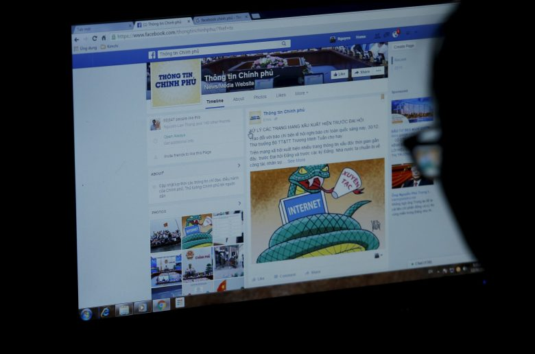 An internet user browses through the Vietnamese government's new Facebook page in Hanoi in a file photo. Photo: Reuters
