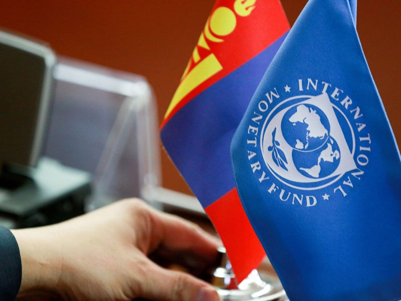 The Mongolia flag is placed next to one for the International Monetary Fund before a briefing in Ulaanbaatar on a US$5.5 billion bailout package for the debt-racked country.  Photo: AFP