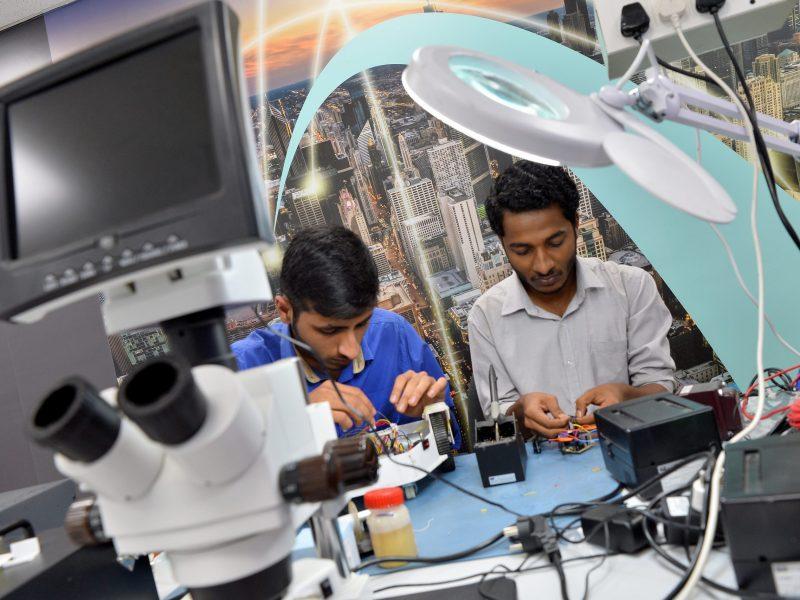 Interns work at a Bangalore start-up, Hacklab. Photo: AFP / Manjunath KIRAN