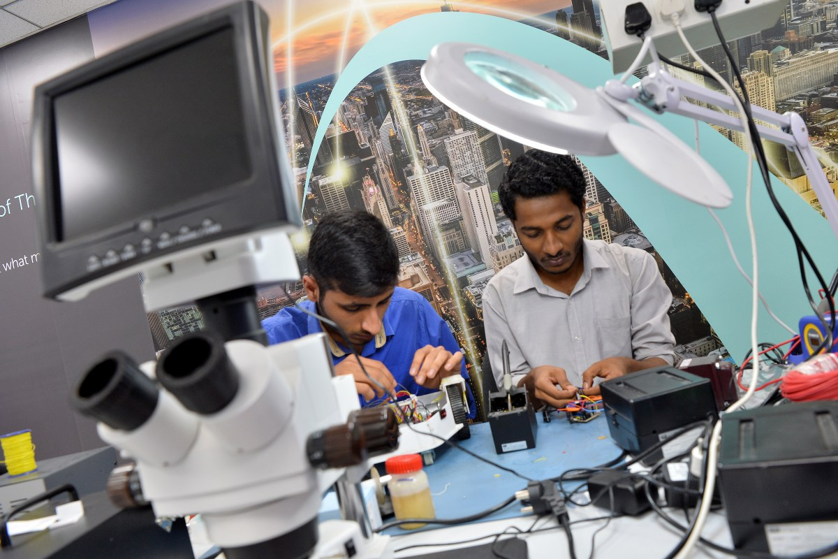 Interns work at a Bangalore start-up, Hacklab. Photo: AFP / Manjunath KIRAN