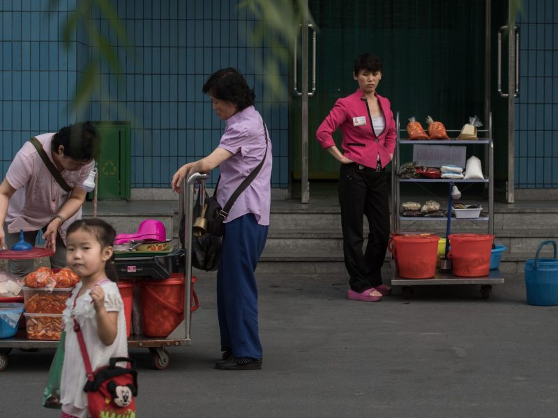 Street vendors waiting for customers on the showcase 'Mirae Scientists Street' in Pyongyang. Photo: AFP/Ed Jones