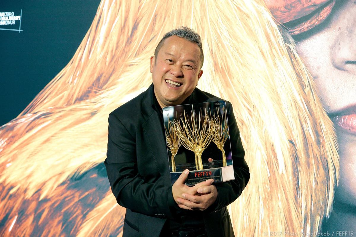 Veteran Hong Kong actor Eric Tsang with his lifetime achievement award in Udine. Photo: FEFF