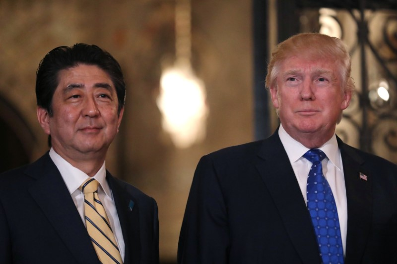 Japanese Prime Minister Shinzo Abe with US President Donald Trump. Photo: Reuters/Carlos Barria