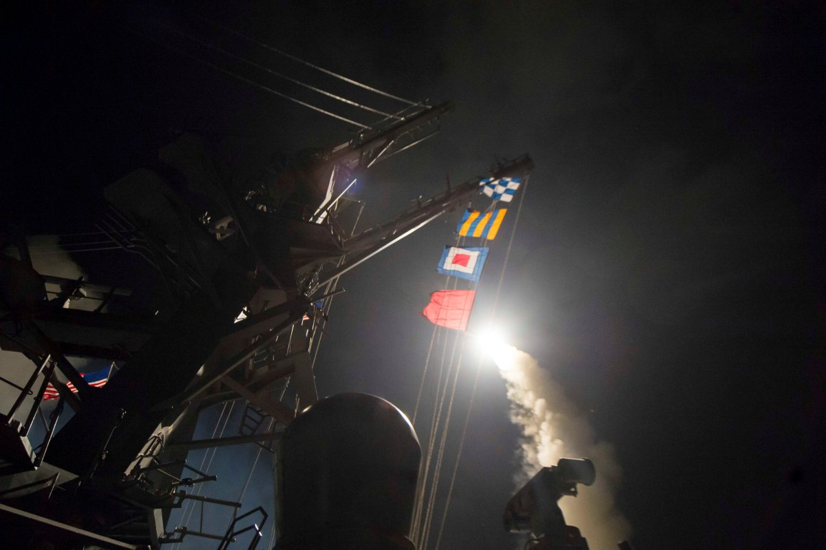 USS Ross fires a tomahawk missile at Syrian targets on April 7. Photo: US Navy handout via Reuters