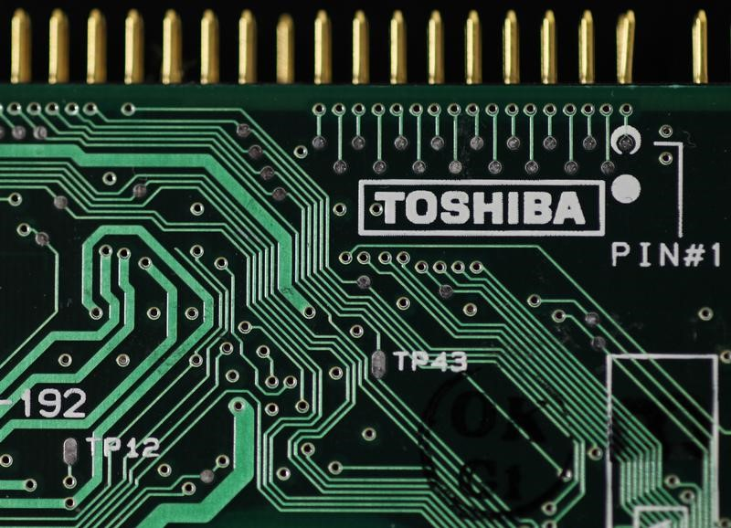 A logo of Toshiba Corp is seen on a printed circuit board. Photo: Reuters/Yuriko Nakao