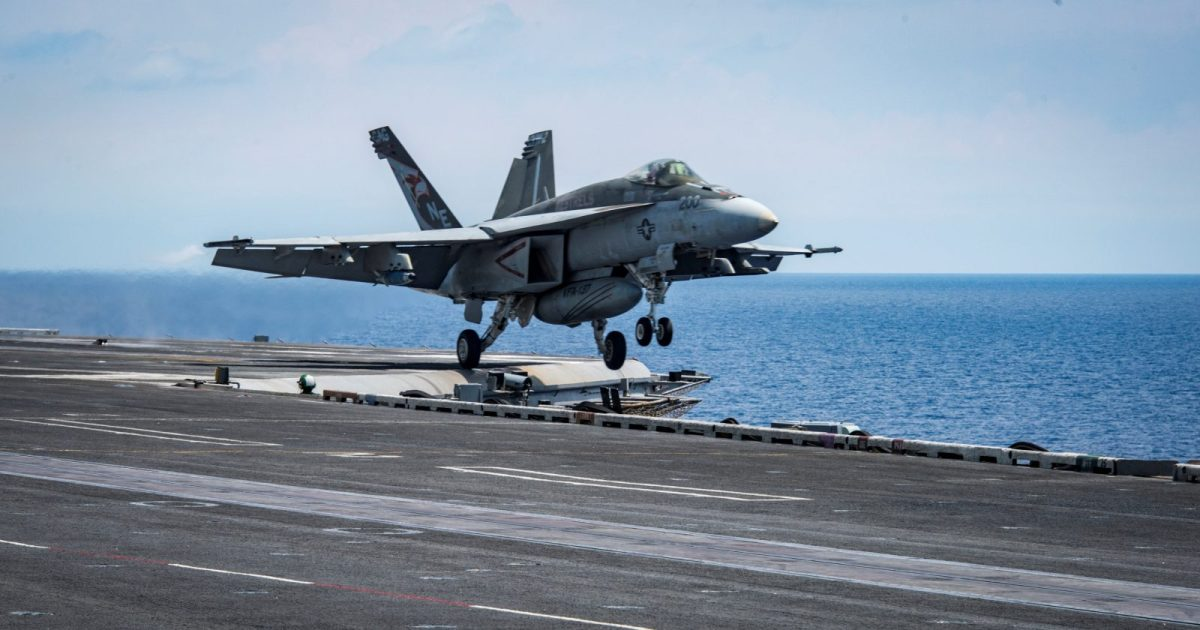 An F/A-18E Super Hornet takes off from the aircraft carrier USS Carl Vinson transiting the South China Sea. Photo: US Navy/Sean M Castellano/handout via Reuters