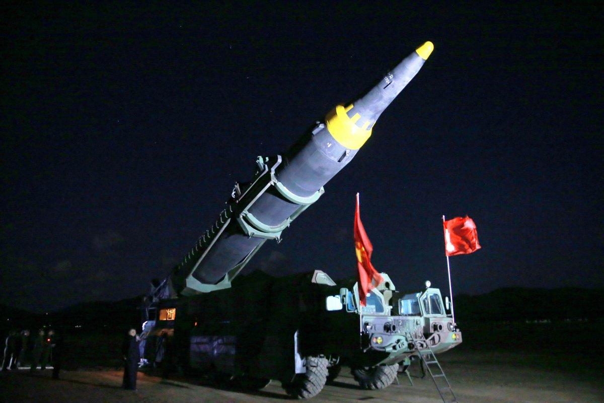 North Korean leader Kim Jong-un inspects the long-range strategic ballistic rocket Hwasong-12 (Mars-12) in this undated image. Photo: KCNA via Reuters