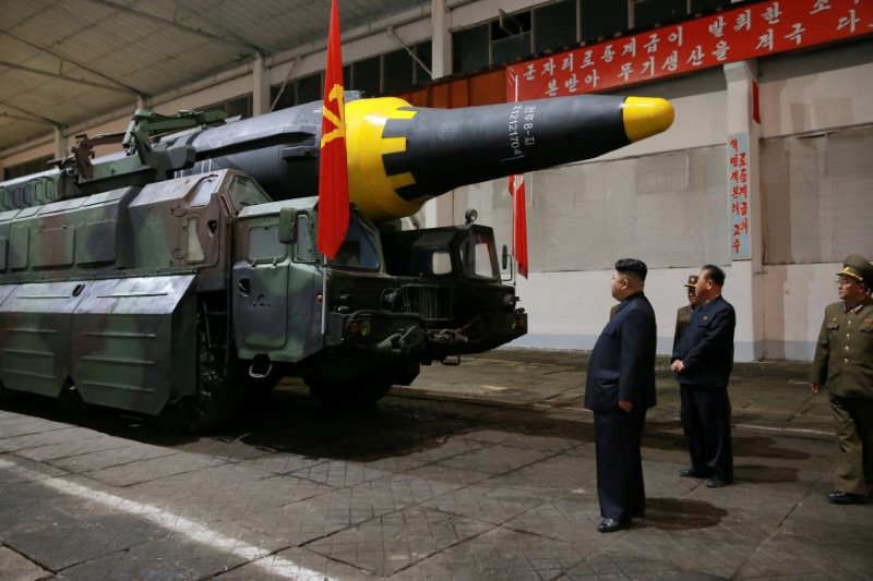 North Korean leader Kim Jong-un inspects the long-range strategic ballistic rocket Hwasong-12 (Mars-12) in this undated image. Photo: KCNA via Reuters