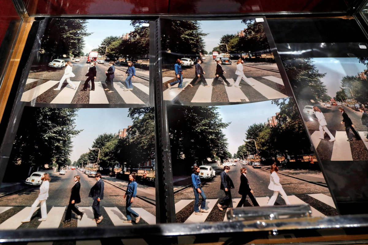 Alternative pictures for the cover of Abbey Road are displayed at an auction of Beatles memorabilia in Paris that was held on March 18, 2017. Some of the songs that appeared on the 1969 album were composed in an ashram in north India. Photo: Reuters/Charles Platiau