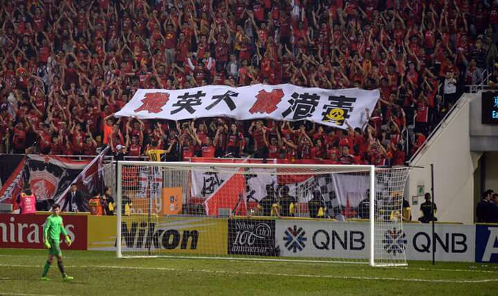 """The banner in the stand containing Guangzhou Evergrande supporters reads: """"Annihilate British dogs, wipe out poisonous Hong Kong independence"""" and could see the Chinese club fined. Credit: offsideHK (Twitter)"""