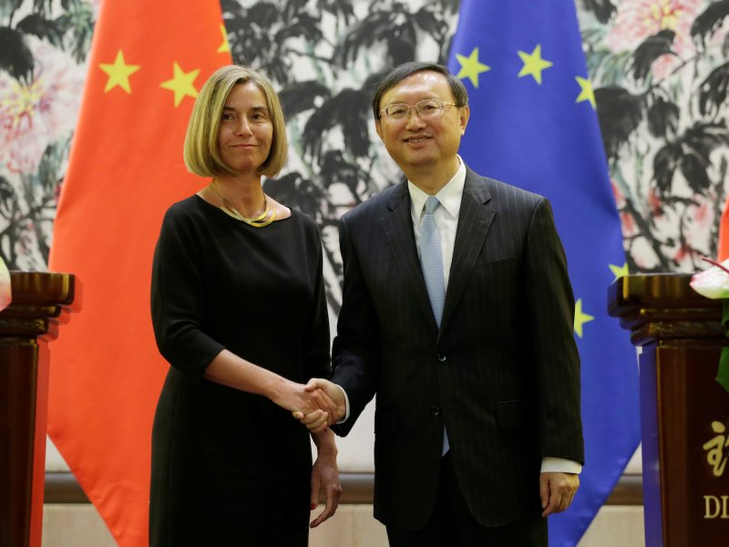 Federica Mogherini, high representative of the European Union for foreign affairs, shakes hands with Chinese State Councilor Yang Jiechi after a joint news conference in Beijing on April 19, 2017. Photo: Reuters/Jason Lee