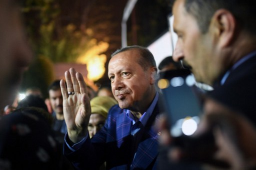 Turkish president Recep Tayyip Erdogan acknowledges supporters during a rally at the conservative Justice and Development Party headquarters in Istanbul, following the results of a nationwide referendum. Photo: AFP/Bulent Kilic