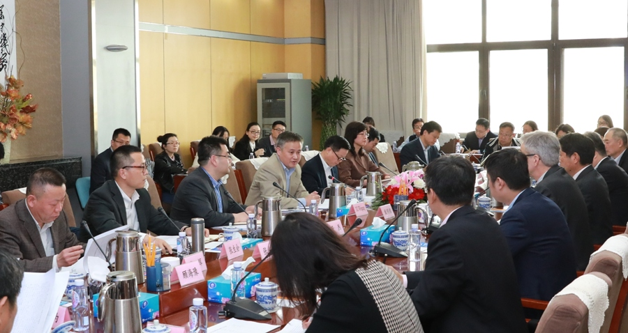 Officials from China's foreign exchange regulator meeting with a delagation of multinational firms on Wednesday. Photo: Handout
