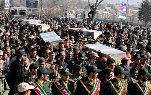 """Members of the Iranian Revolutionary Guard carry the caskets of Iranian """"volunteers"""", who were killed in the northern province of Aleppo by jihadists in Syria. Photo: AFP, Atta Kenare"""