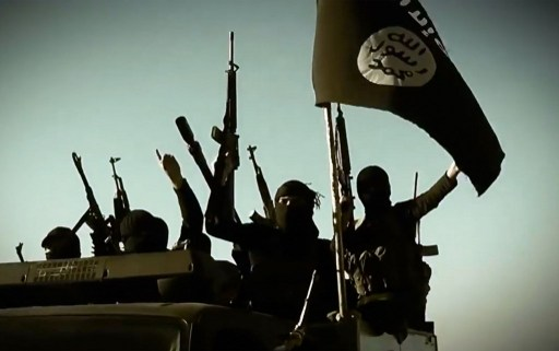 An image grab from propaganda video released by ISIS shows fighters with the trademark Jihadists flag. Photo: AFP