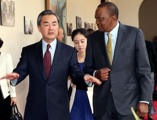 Chinese Foreign Minister Wang Yi speaking with Kenyan President Uhuru Kenyatta. Photo: AFP