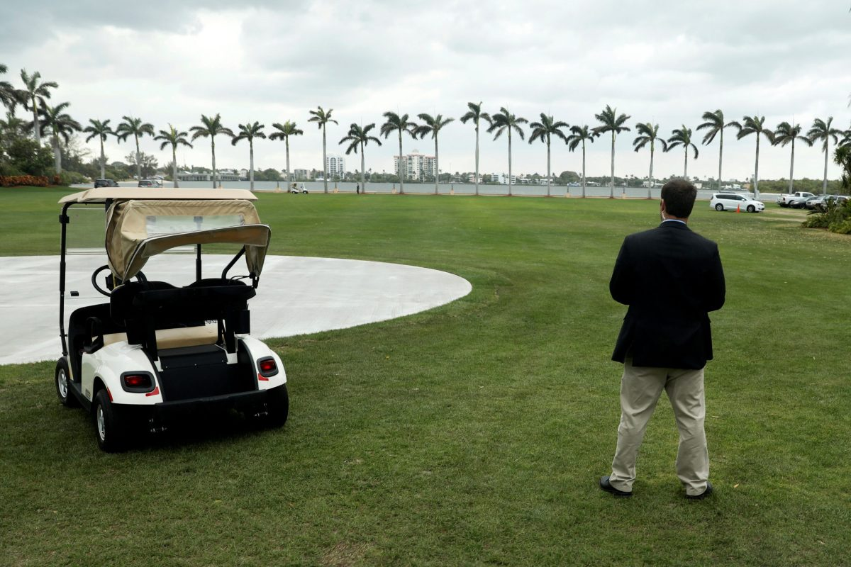 Bunker mentality ... a Secret Service agent stands watch over the golf course at President Trump's Mar-a-Lago Club in Palm Beach, Florida, setting for this week's US-China summit. Photo: Reuters
