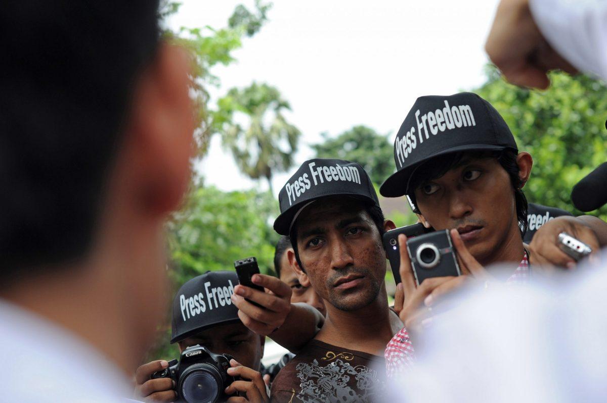 Myanmar journalists wearing caps reading 'Press Freedom'. Photo: AFP/ Soe Than Win