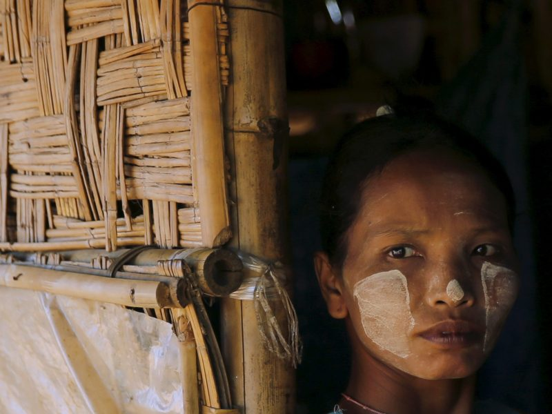 A Myanmar woman stands at the door of her bamboo shack on November 4, 2015.  Photo: Reuters/Jorge Silva