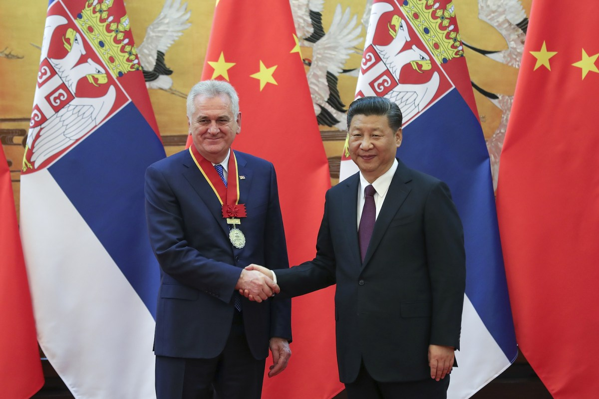 Xi Jinping shakes hands with  Tomislav Nikolic during an honorary citizenship ceremony for the Serbian president at the Great Hall of the People in Beijing on March 30, 2017. Photo: Reuters, Lintao Zhang