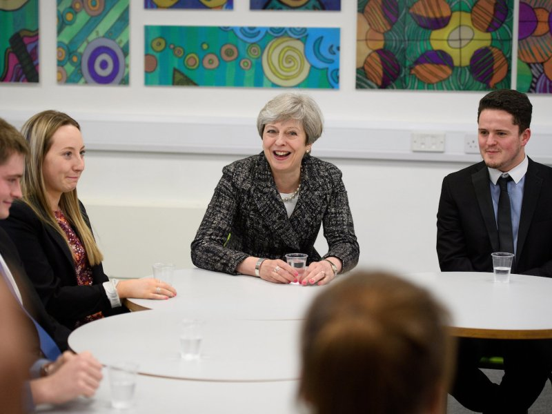 British Prime Minister Theresa May talks on April 21, 2017, to students at a school in Maidenhead, Berkshire, England, who will be voting in their first UK general election in June. Photo: Reuters/Leon Neal/Pool