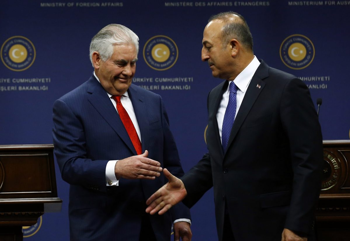 U.S. Secretary of State Rex Tillerson shakes hands with Turkish Foreign Minister Mevlut Cavusoglu on March 30. Photo: Reuters, Umit Bektas