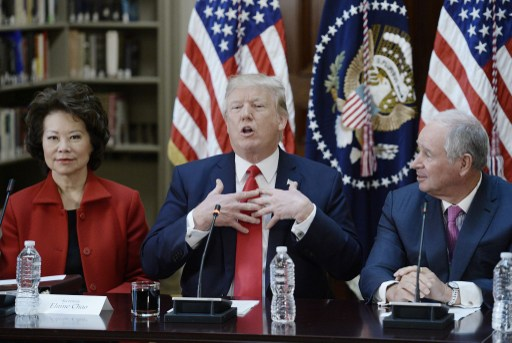 US President Donald Trump flanked by US Secretary of Transportation Elaine Chao, left, and Stephen A. Schwarzman, Chairman, CEO and Co-Founder of Blackstone during a strategic and policy discussion with CEOs. Photo: dpa, Olivier Douliery