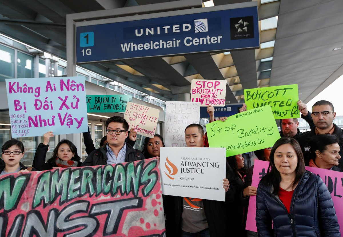A protest at O'Hare International Airport in Chicago on April 11, 2017, follows the forcible removal of Dr David Dao from a United Airlines flight on April 9 by Chicago Aviation Police. Photo: Reuters/Kamil Krzaczynski