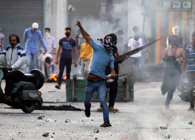 A Kashmiri protester throws a stone toward police during a strike. Photo: Reuters / Files