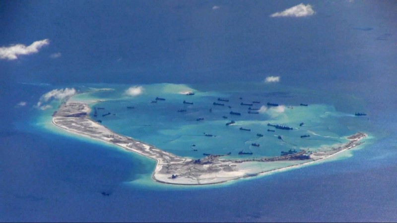 The US Navy claims this image shows Chinese dredging vessels in the waters around Mischief Reef in the  Spratly Islands in the South China Sea in 2015. Photo: US Navy via Reuters