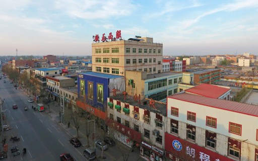 Aerial view of houses and buildings in Rongcheng county, one part of the new special economic zone Xiong'an New Area. Photo: AFP