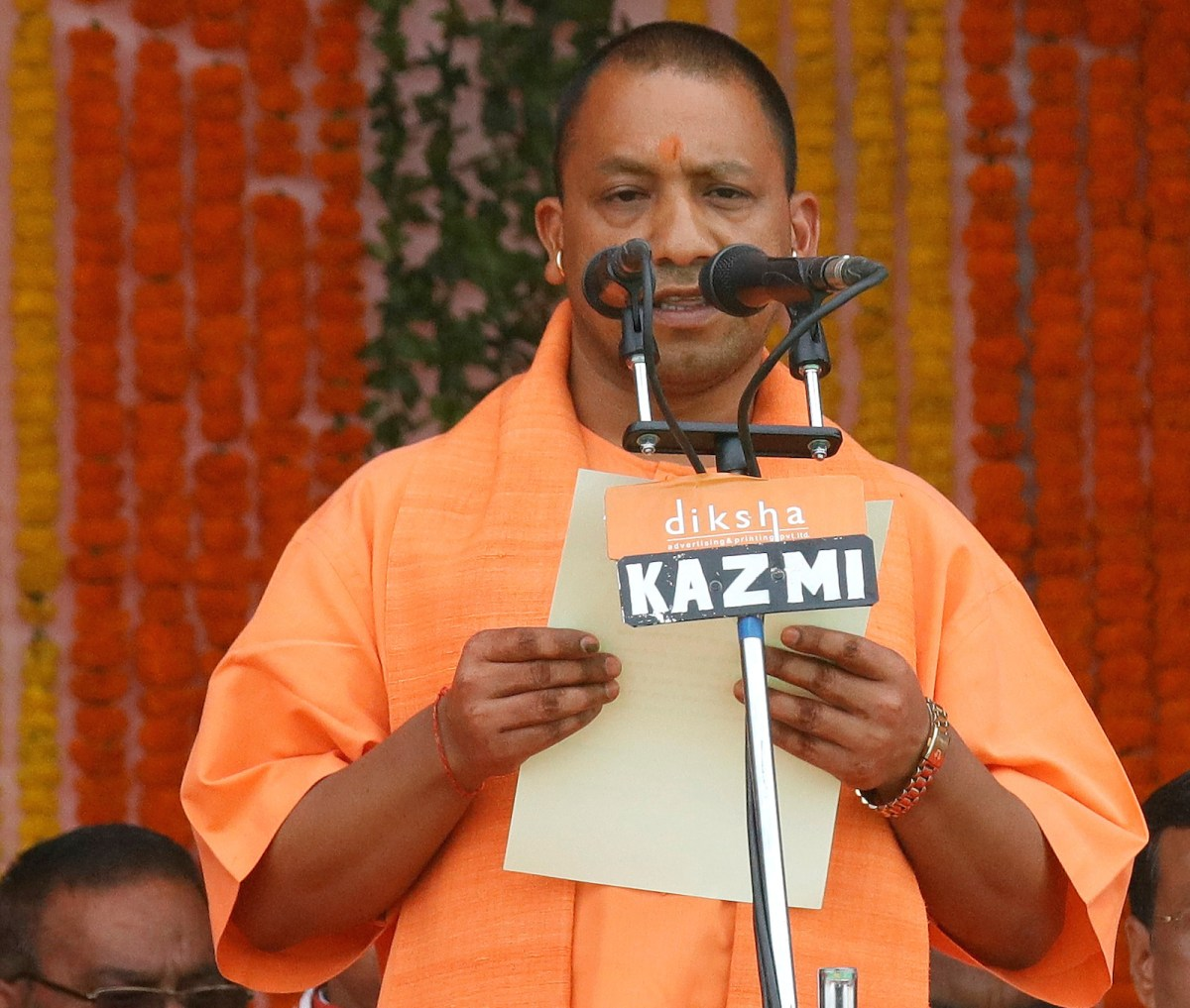 Yogi Adityanath takes the oath as the new chief minister of Uttar Pradesh during a swearing-in ceremony March 19. His appointment by Prime Minister Narendra Modi is controversial because of the firebrand cleric's anti-Muslim views. Photo: Reuters/Pawan Kumar