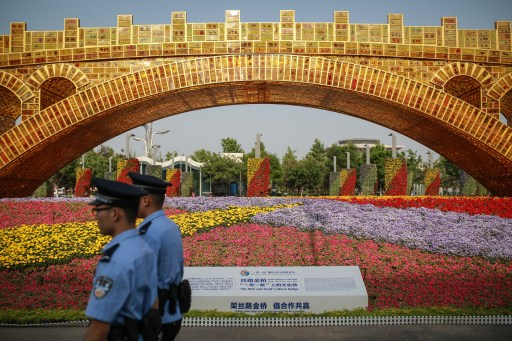 Chinese police patrol past a display built for the Belt and Road Forum in Beijing. President Xi used the forum to set out a grand trade vision that China hopes will be an alternative to globalization. Photo: Agence France-Presse.