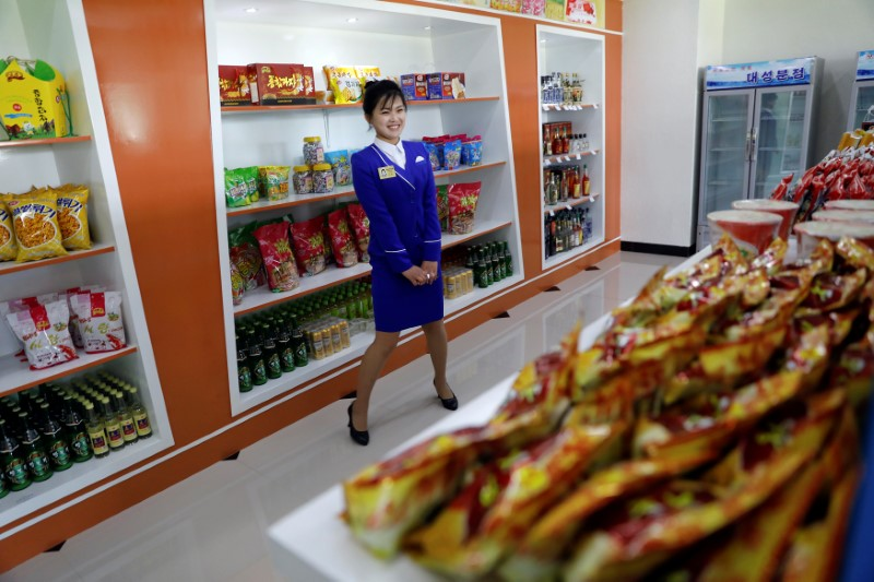Retail competition is coming? A shop assistant in a store in Ryomyong street in Pyongyang. Photo: Reuters/Damir Sagolj