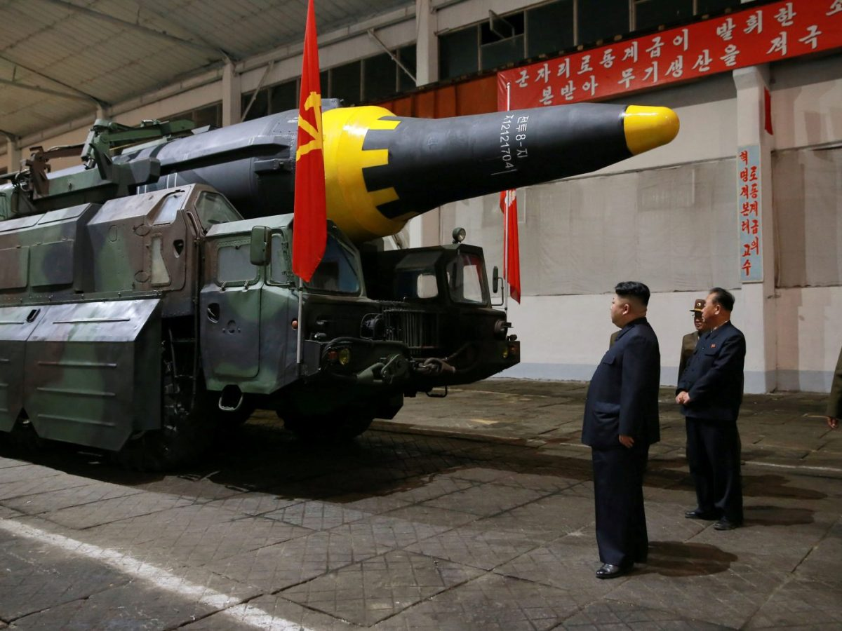 North Korean leader Kim Jong-un inspects the long-range strategic ballistic rocket Hwasong-12 in this undated image. Photo: KCNA via Reuters