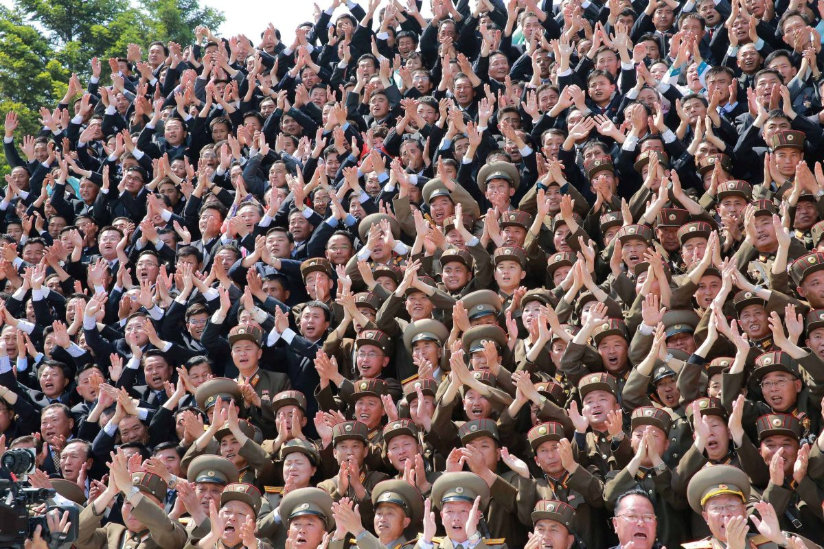North Korean scientists and technicians, who developed missile Hwasong-12 cheer North Korean leader Kim Jong-un in this undated image. Photo: KCNA via Reuters