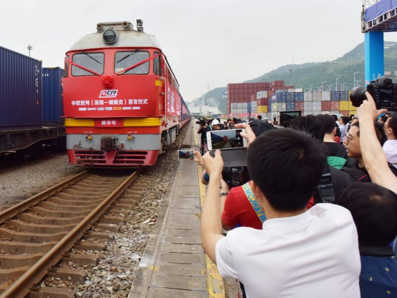 People take pictures of the first freight train from Shenzhen to Minsk, capital of Belarus, that set out of Yantian Port in Shenzhen in May 2017. Photo: Reuters / stringer