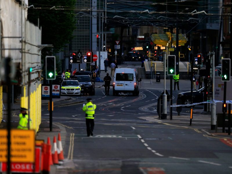 Police patrol the secure area outside the Manchester Arena. Photo: Reuters/Jon Super