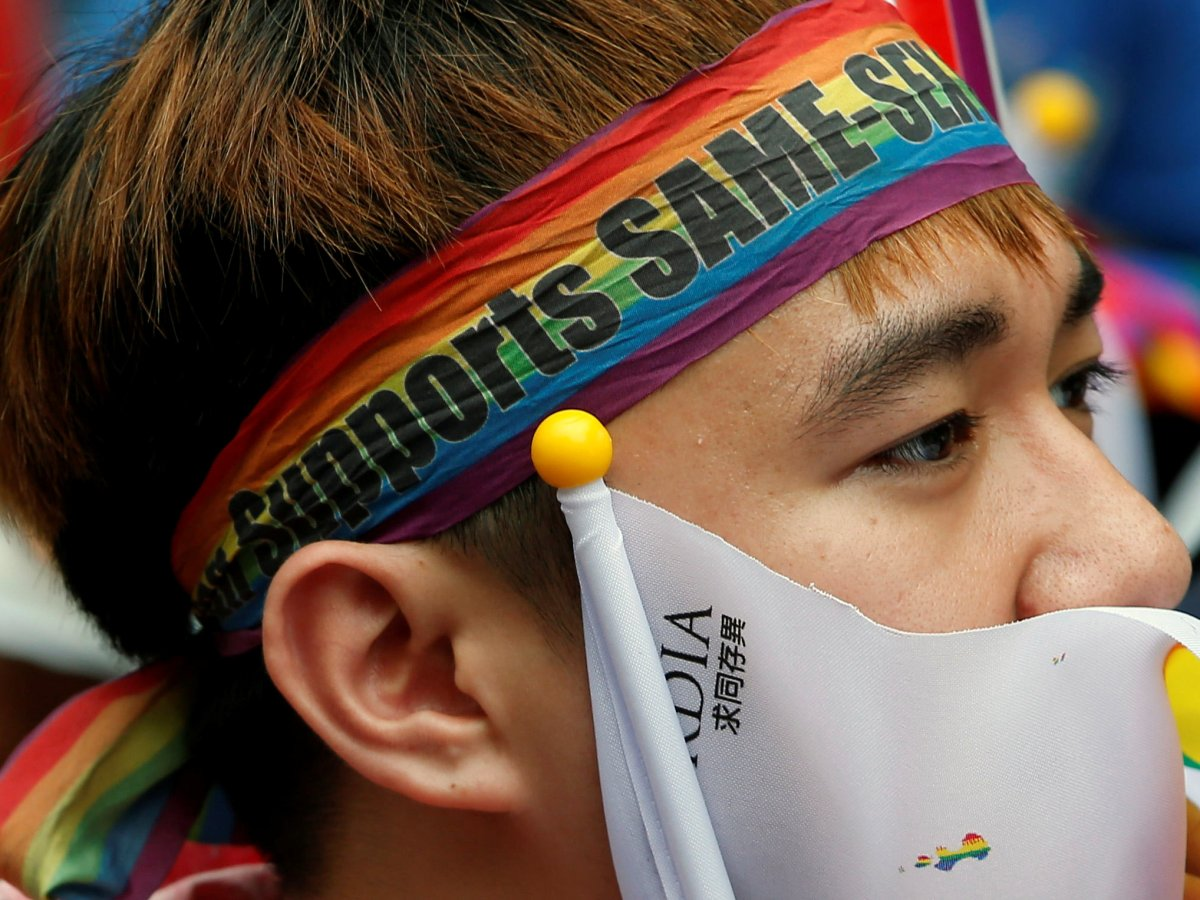 A supporter reacts during a rally after Taiwan's constitutional court ruled that same-sex couples have the right to legally marry, the first such ruling in Asia, in Taipei. Photo: Reuters/Tyrone Siu