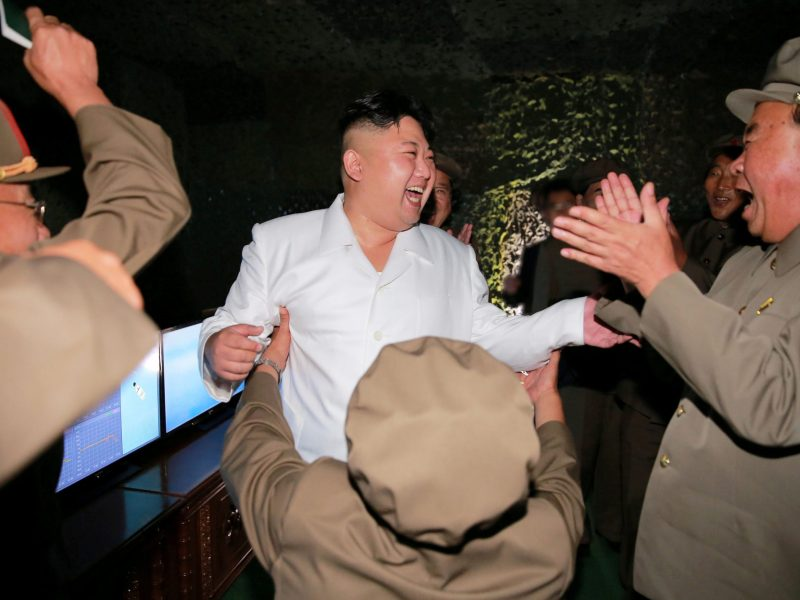 North Korean leader Kim Jong-un reacts as he inspects a test-fire of strategic submarine-launched ballistic missile with Ri Pyong-chol (right). Photo: KCNA via Reuters